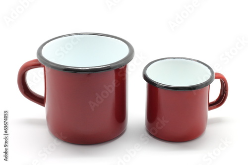 Enamel mugs isolated on white background