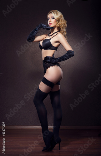 A beautiful cabaret dancer in sexy vintage lingerie