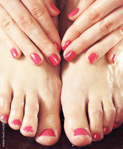 Beautiful female feet in spa composition