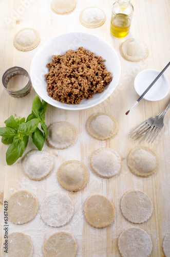 home made ravioli on wooden table