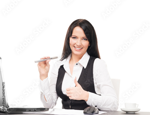 A business woman with an electronic cigarette working in office