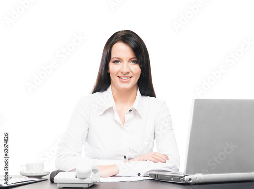 canvas print picture A businesswoman working in an office isolated on white
