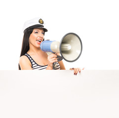 A sexy sailor girl screaming into a megaphone on white