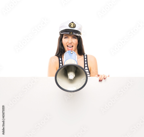 A sexy sailor girl screaming with a megaphone on white