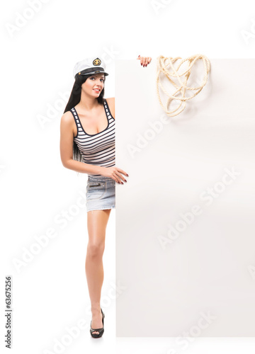 A sexy sailor girl isolated on a white background