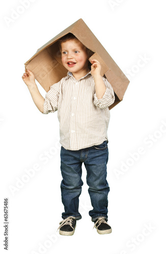 Funny little boy with a box on his head