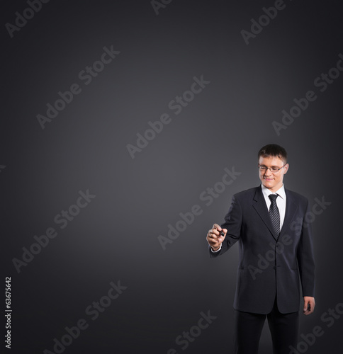 Successful businessman writing imaginary text on grey