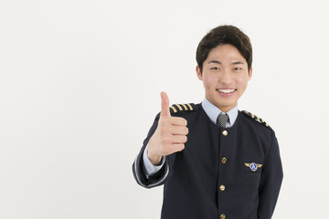 Cheerful airline pilot with thumb up