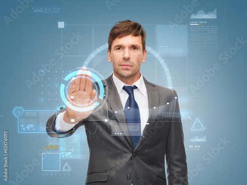 attractive buisnessman wotking with virtual screen