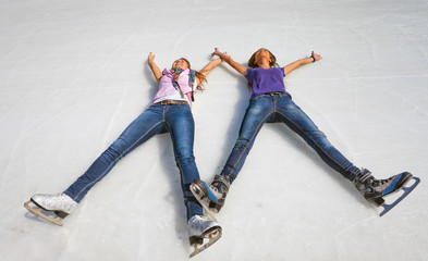 Image of group cute young girls lying on the ice