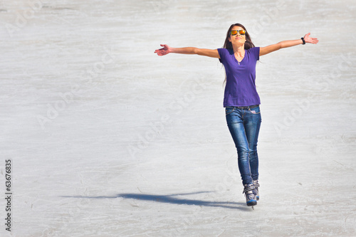 successful young woman skating outdoor