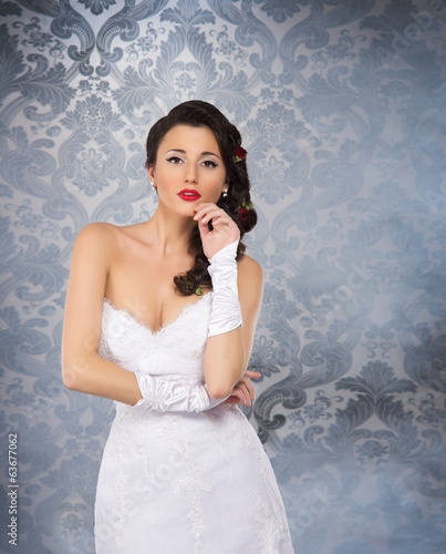 A beautiful bride on a vintage background