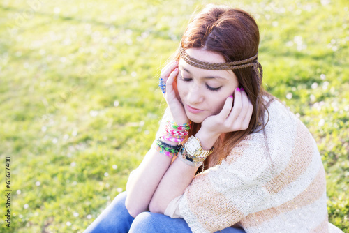 Portrait of pensive young girl hippie stylish, outdoor.