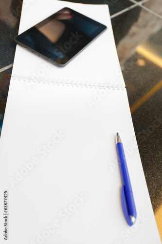 background of notebook with copy space, pc tablet and pen