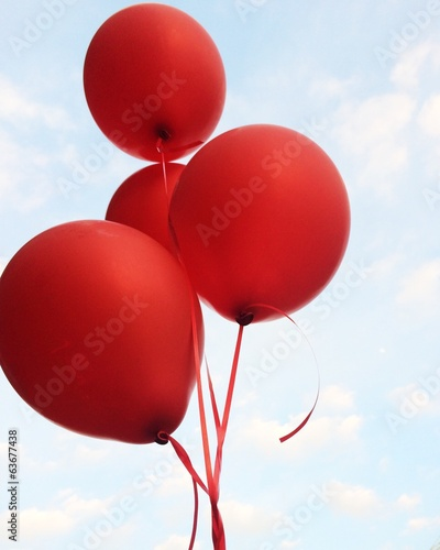 red balloons against the sky
