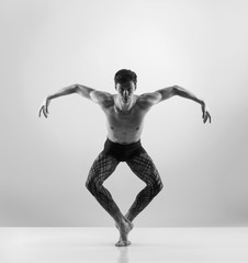 Sporty and athletic ballet dance. Black and white image.