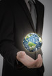 Business man holding earth in his hand (Elements of this image f