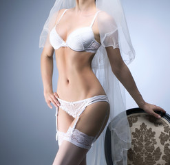 Young sexy bride in erotic lingerie over blue