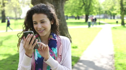 Portrait of an attractive woman with her smart phone