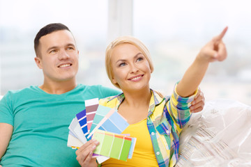 couple looking at color samples in new home