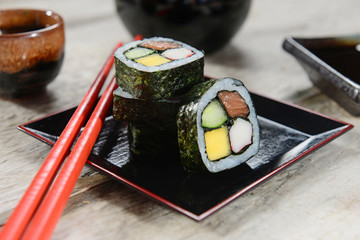 Colorful sushi made with mango, cucumber, salmon and kani