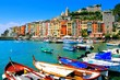 Leinwanddruck Bild - Colorful harbor view at Portovenere, Italy with boats