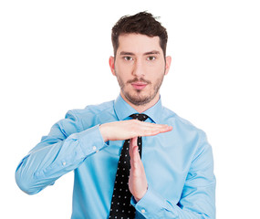 Young business man giving Time-out gesture on white background