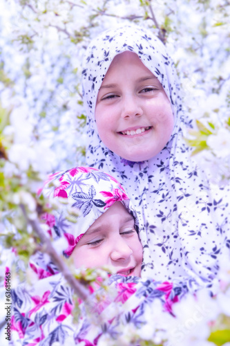 Two little muslim girls together