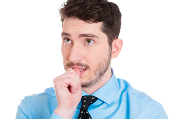 Anxious young business man biting his thumb