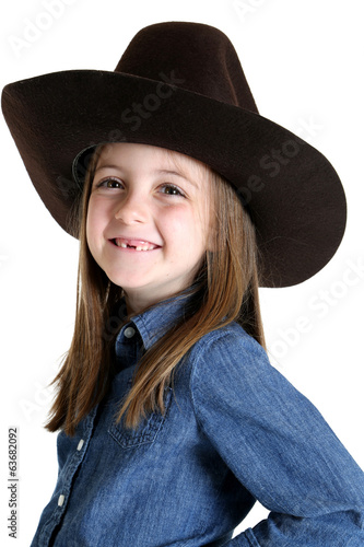 Cute young cowgirl missing her front teeth smiling