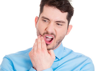 Toothache. Young man having sensitive teeth, pain