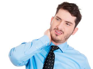 Portrait young businessman having neck pain, white background