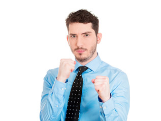 Boxer. Young business man with fists up in air, ready to fight