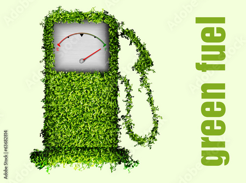 the concept of ecological fuel. Green fuel pump out of the grass