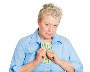 Penny pinching older woman, possessive of her money