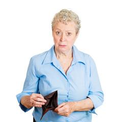 Broke older woman showing empty wallet, on white background