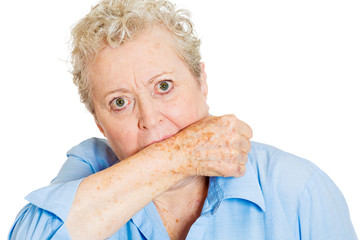 Portrait senior woman biting arm isolated white background