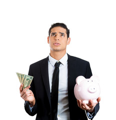 Save or spend? Financial decision Businessman holding piggy bank