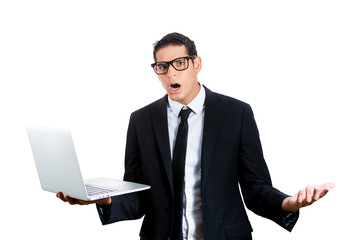 Surprised young business man. Bad news on computer