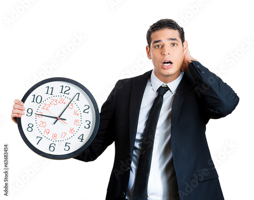 Businessperson running out of time, holding clock