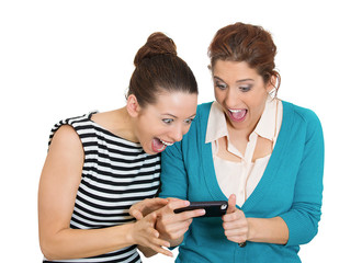 Surprised women looking on cell mobile phone white background