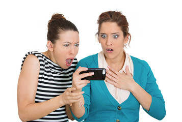 Upset women looking on mobile cell phone on white background