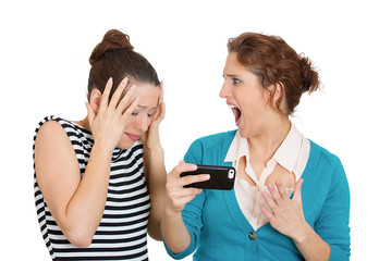 Upset women receiving bad news on mobile cell phone
