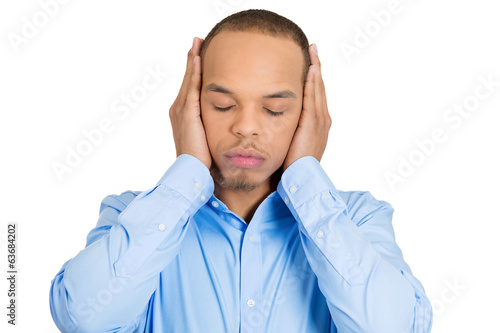 Hear no evil concept. Man covering ears, ignoring situation