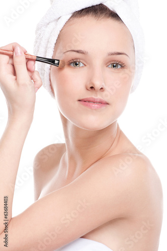 Beautiful woman with make up brush