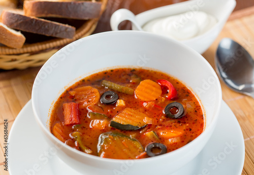 Vegetables soup in plate on table