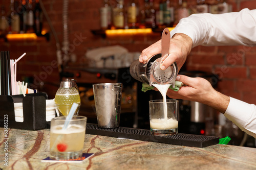 Bartender is making a cocktail