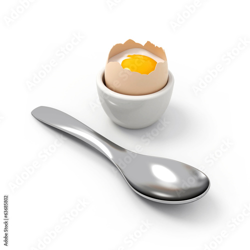 Crushed soft-boiled egg witch spoon in front
