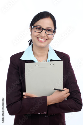 Smiling business woman holding a clipboard