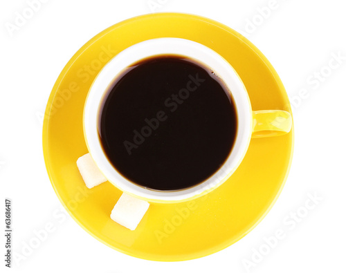Yellow cup and saucer isolated on white